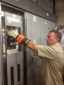 Denver Commercial Electrician testing damaged lighting contactor